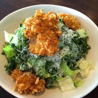 Collard Greens Caesar Salad with cornflake crisped oysters